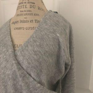 Light gray women's reversible sweater blouse. NWT